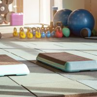 The interior of rehabilitation gym, with equiment: balls, mats, steps and weights