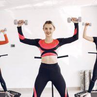 Women group on sport trampoline. Fitness workout.